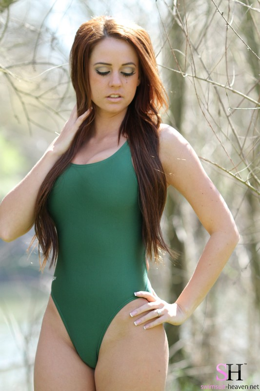 curvy chick Brittany in green speedo swimsuit