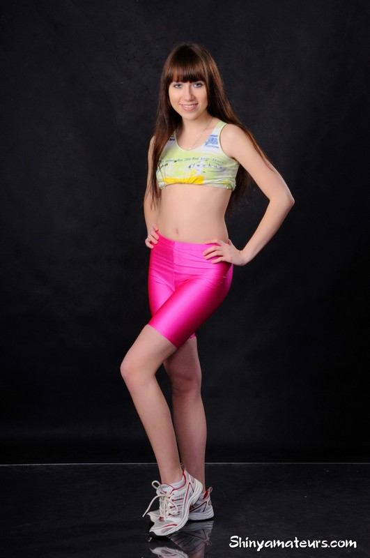 yoga teacher Eleonora in pink spandex shorts