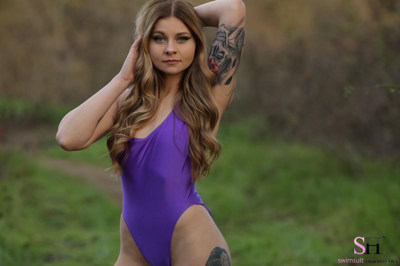 tattooed girl Angel in purple swimsuit