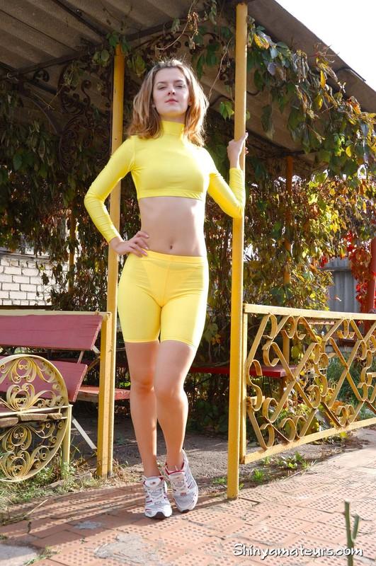 jogger girl Jenya in sexy yellow uniform