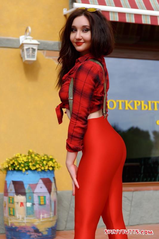 nubile model Anna A in shiny red leggings