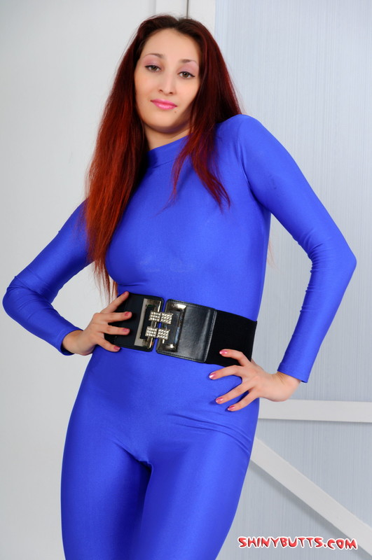 gorgeous model Zoya in blue catsuit & boots