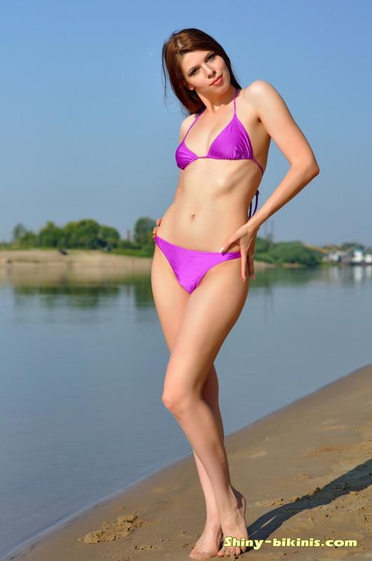 sexy female Mila in purple bikini