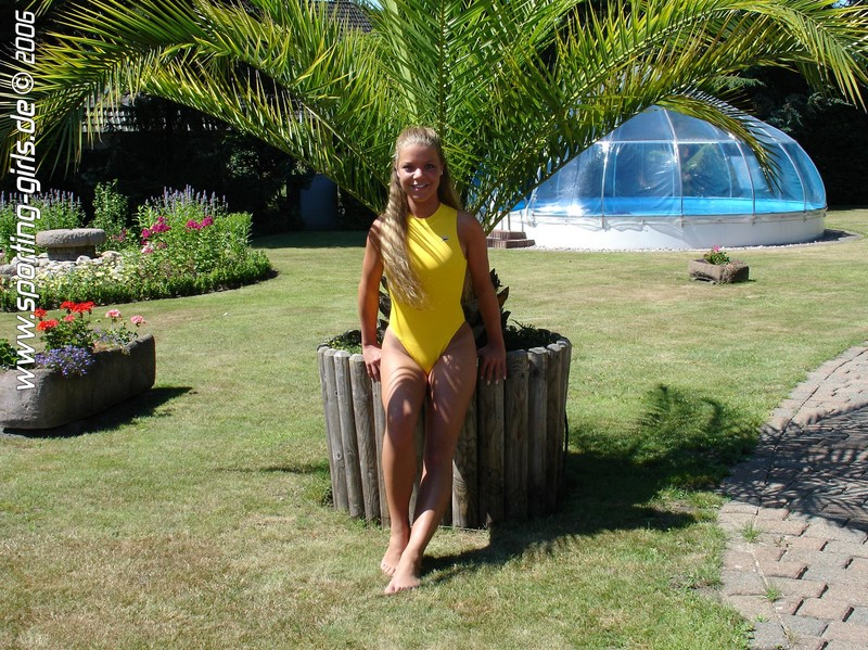 pretty german babe in yellow swimsuit