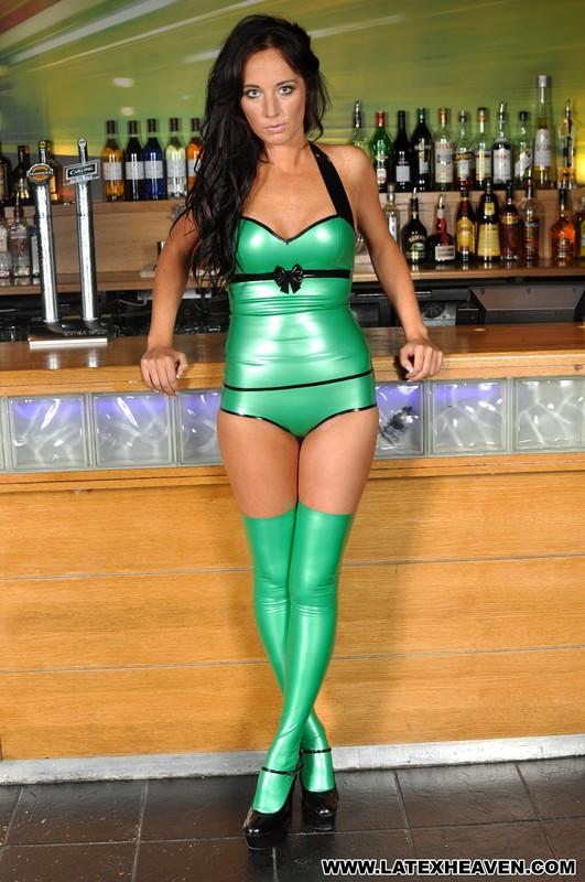 bartender girl Jemma in green latex stockings & lingerie