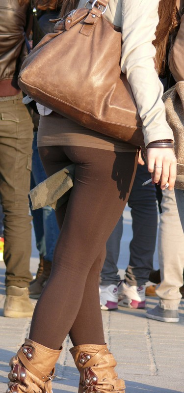 smoker girl in tight brown leggings