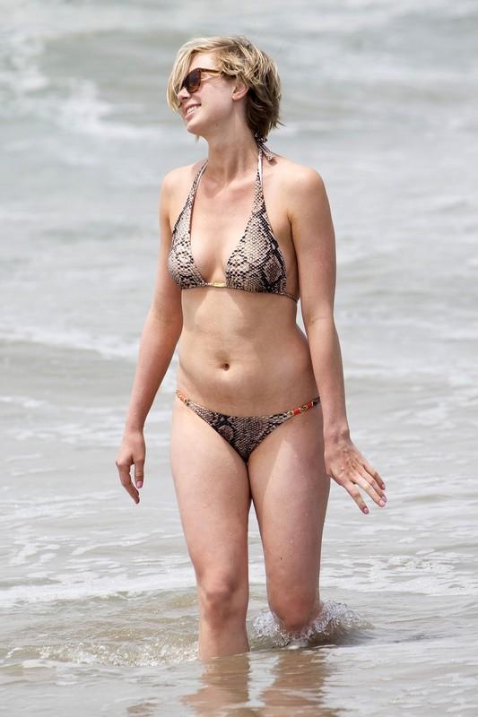 pretty blonde lady in snake skin bikini