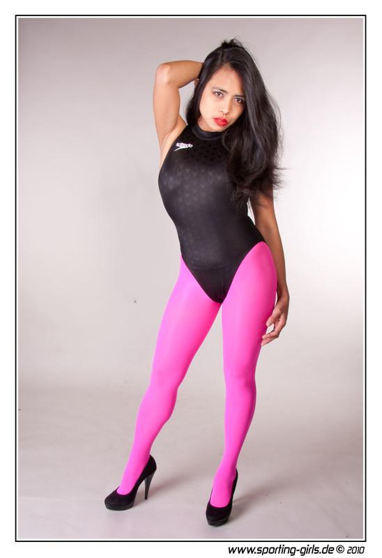 leggy model Guada in pink tights & black speedo swimsuit
