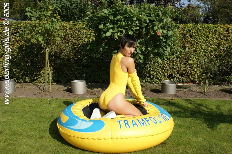 charming model Diana in yellow 1 piece swimsuit
