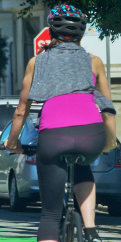 magnificent cyclist lady in tight spandex pants