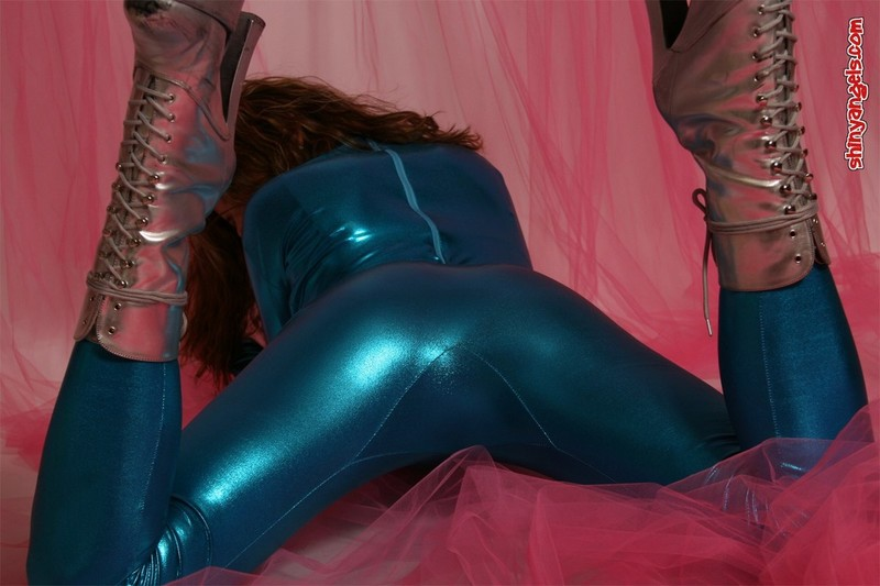 handsome shiny angel in cyan catsuit