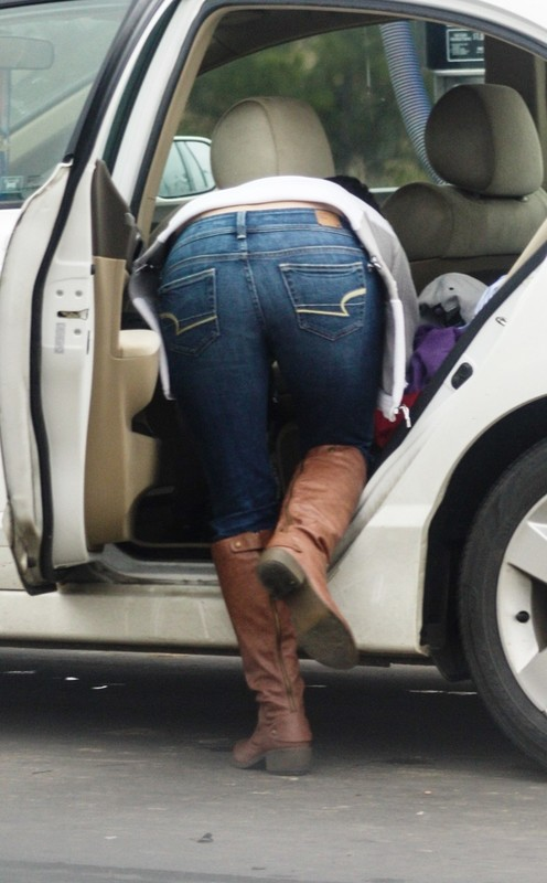 carwash lady in denim pants & boots