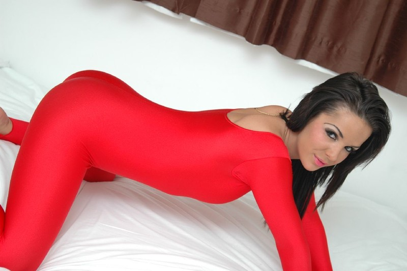 handsome shiny angel in red catsuit