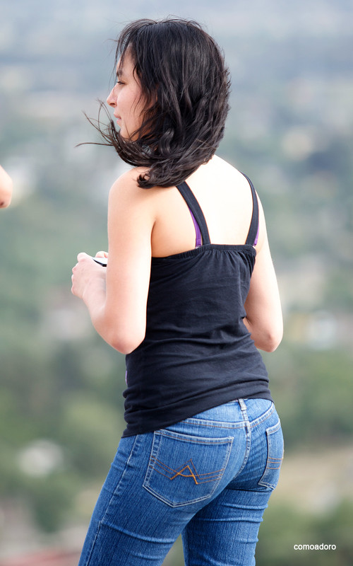 lovely female in tight blue jeans