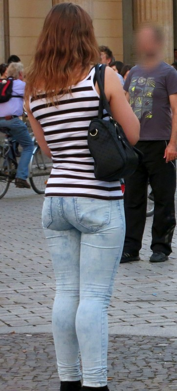 handsome lady in tight blue jeans