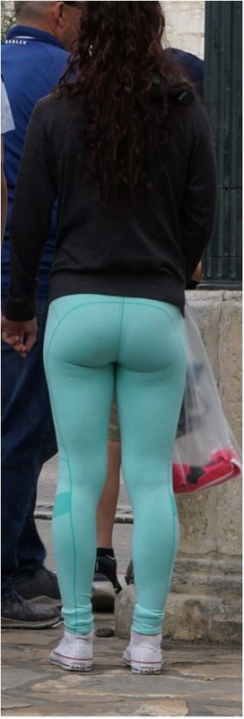 charming lady in cyan yogapants