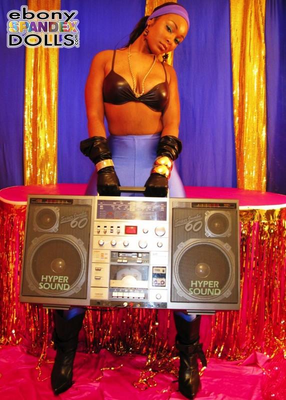 dj girl Yasmin in purple lycra pants & boots