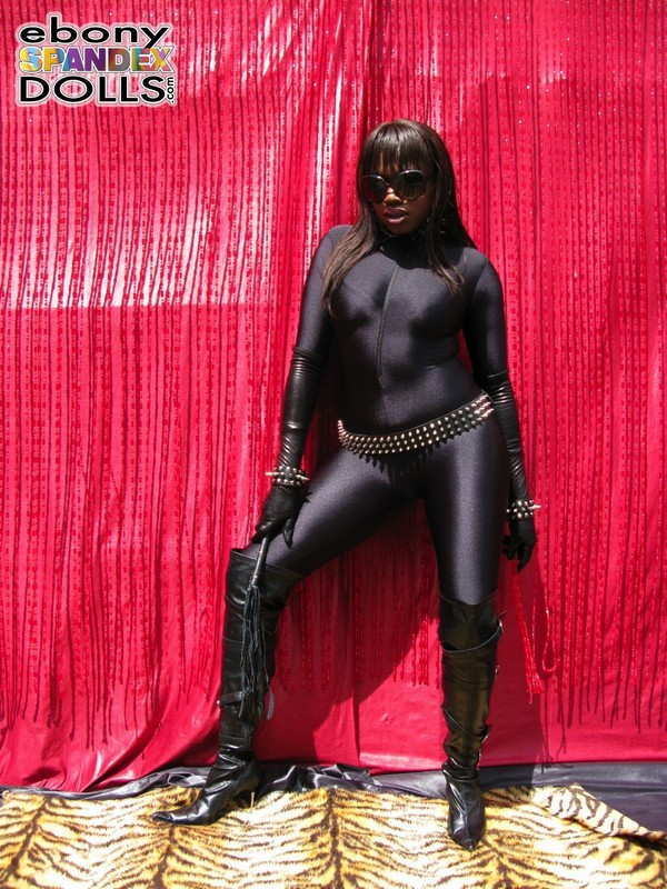 african dominatrix Sheree in catsuit & boots