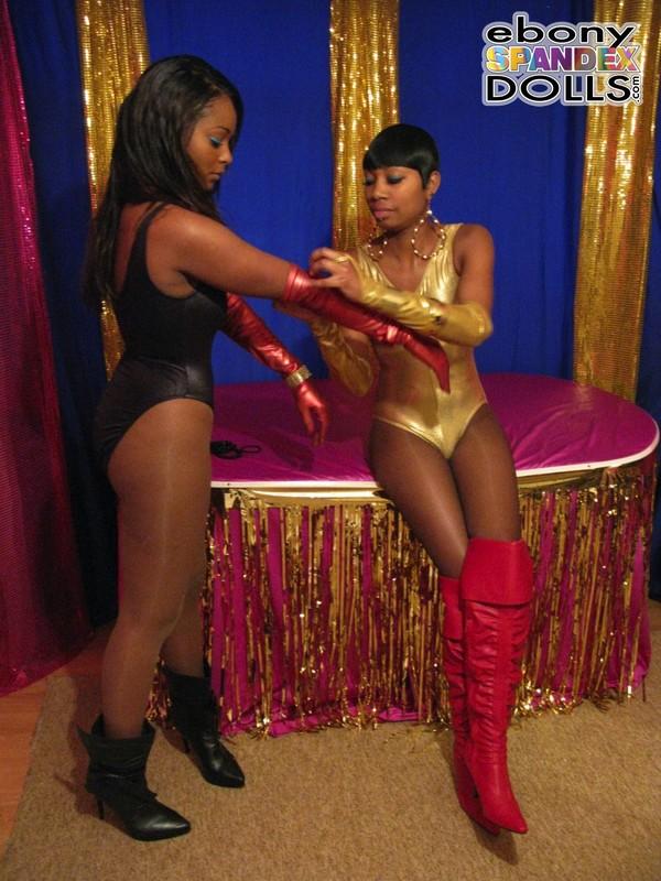 ebony lesbian girls in naughty leotards & boots