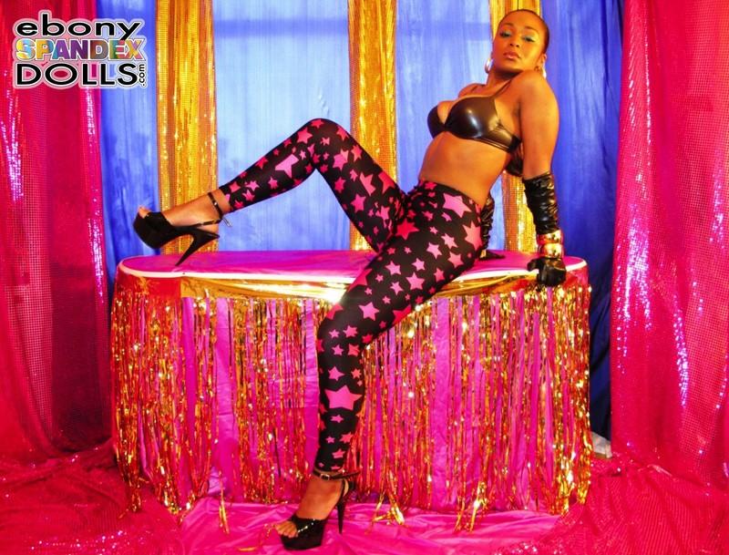 ebony spandex doll Yasmin in kinky purple star leggings