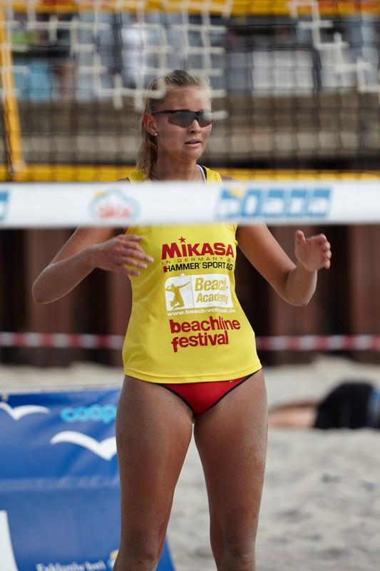 sand volleyball girls in sexy bikini thongs