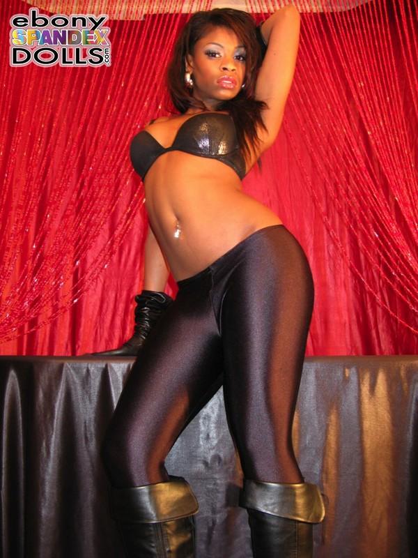 ebony model Peaches in leggings & leather boots