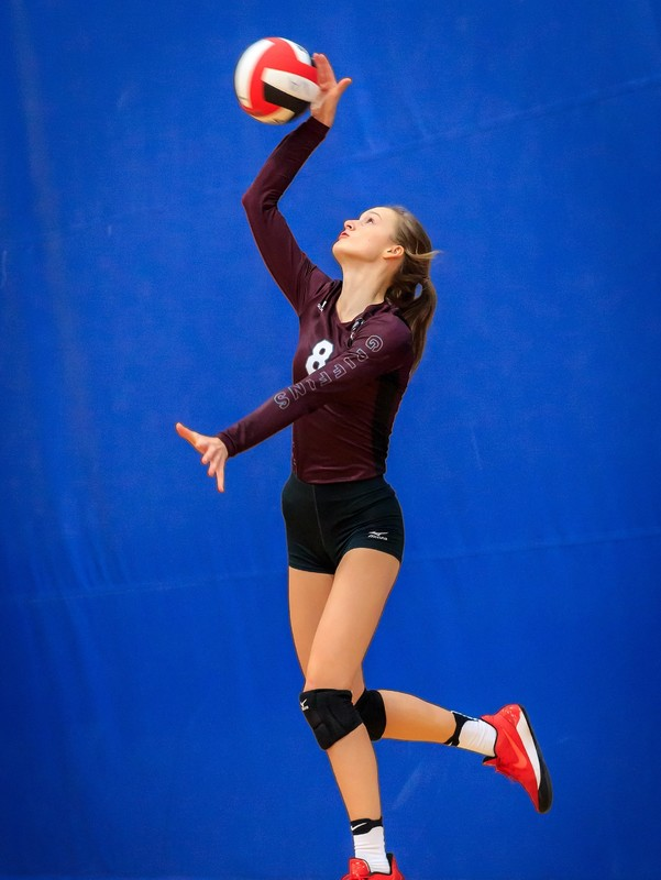 charming college teens in spandex volleyball shorts