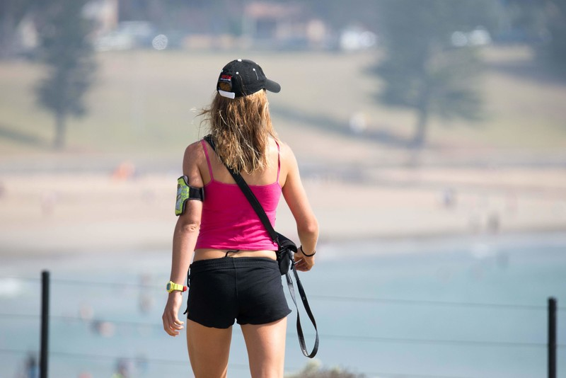 park jogger lady in fitness shorts