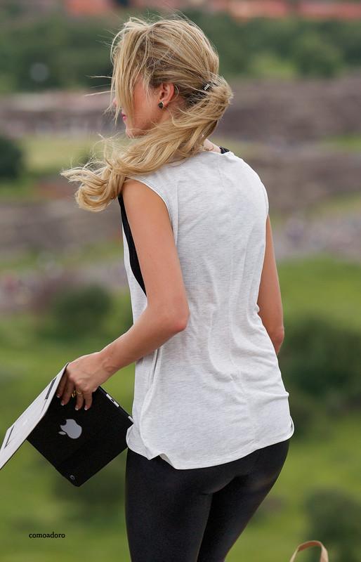 naughty tourist babe in black shiny leggings