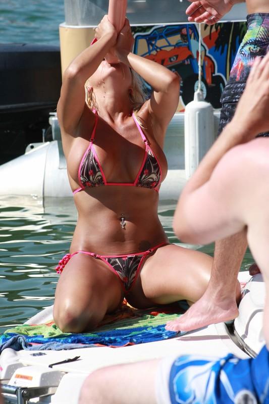 motorboat girl in kinky bikini