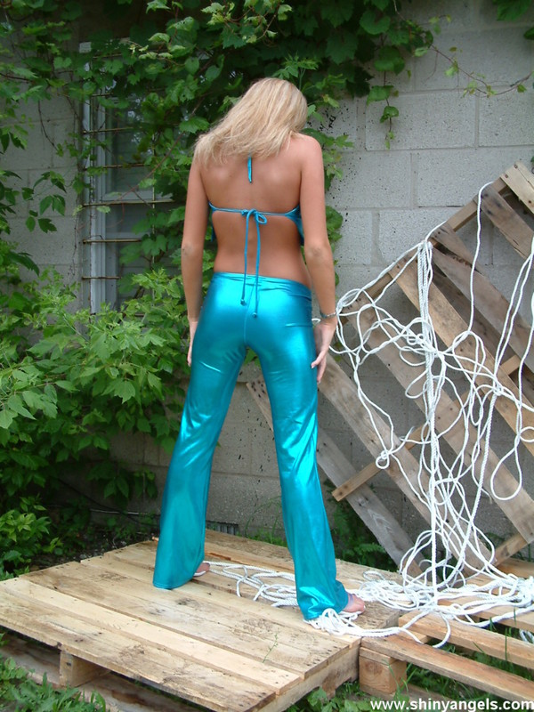 blonde chick in blue shiny outfit
