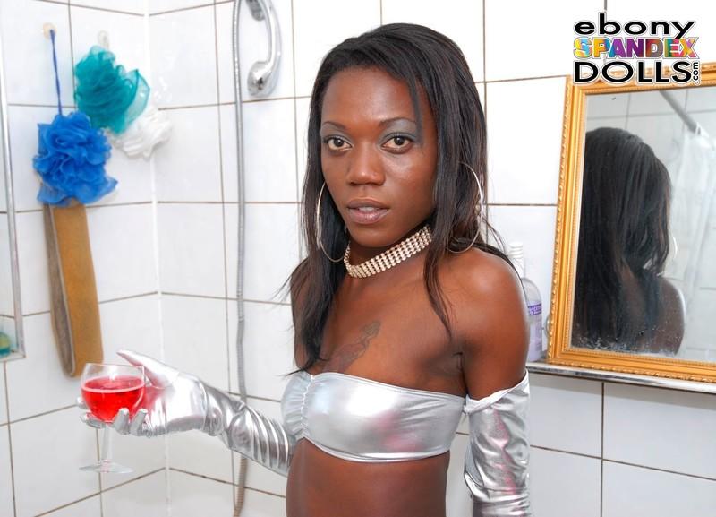 ebony model Tania in wetlook silver leggings
