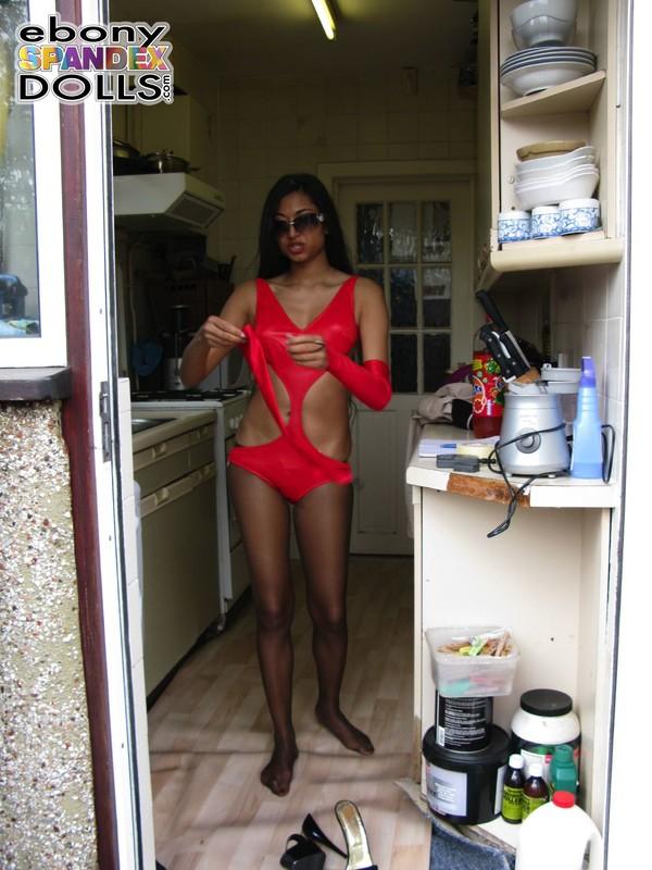 ebony model Maya in pantyhose & red swimsuit