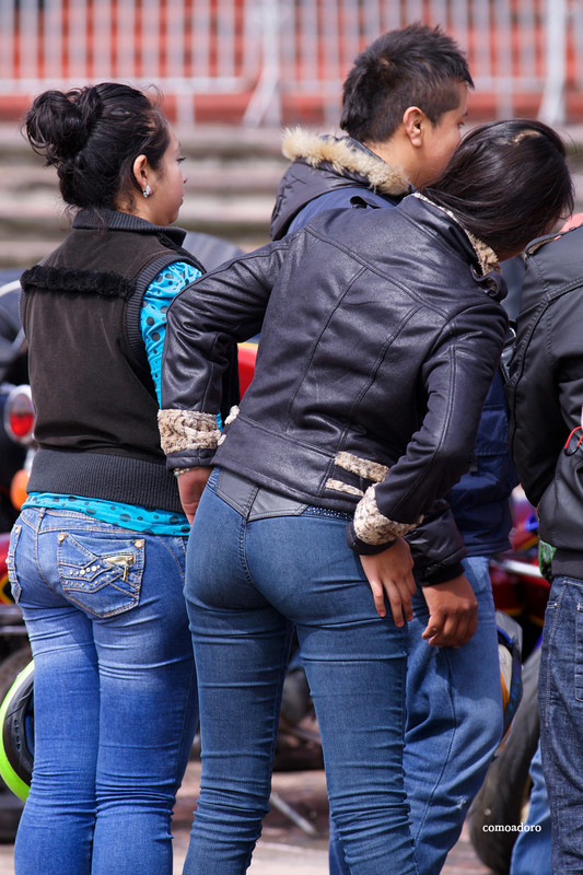 motorbike show lady in leather jacket & tight blue jeans