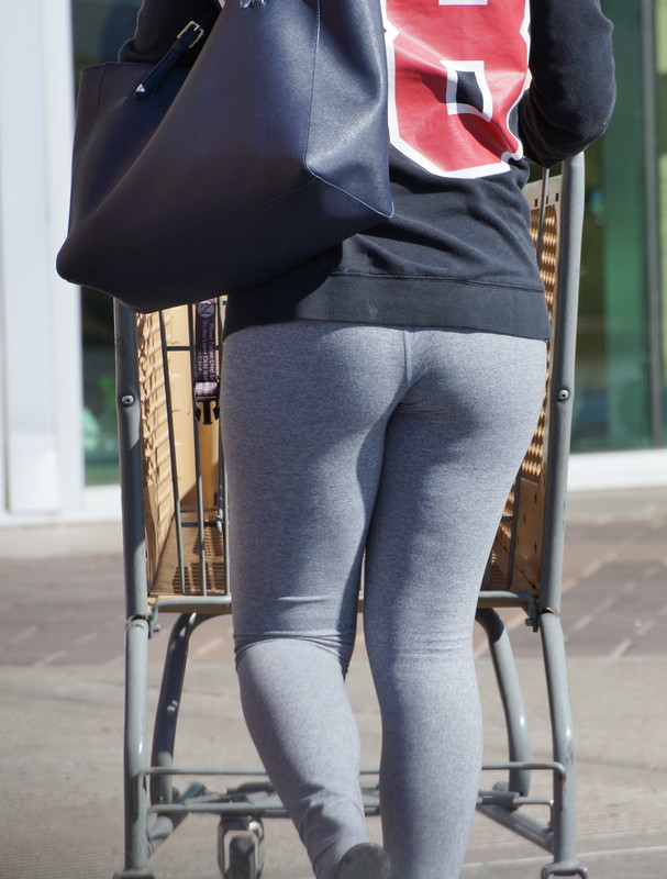 gorgeous lady in grey lycra pants
