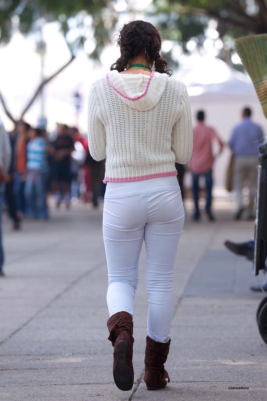 creerful hispanic chick in candid denim pants