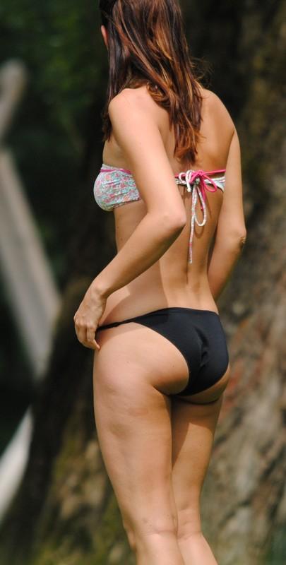 skinny sunbather lady in a city park