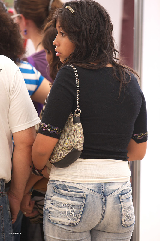 sweet hispanic babe in tight denim pants