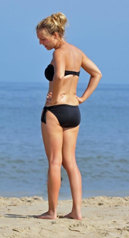 gorgeous beach lady in black bikini