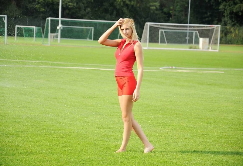 soccer girl Mary in wet red spandex shorts