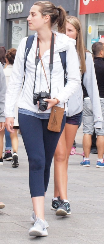 photographer lady in candid blue leggings