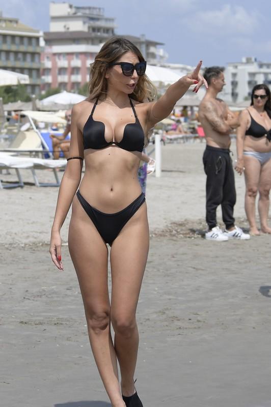 curvy babe Sarah Altobello in wet black bikini