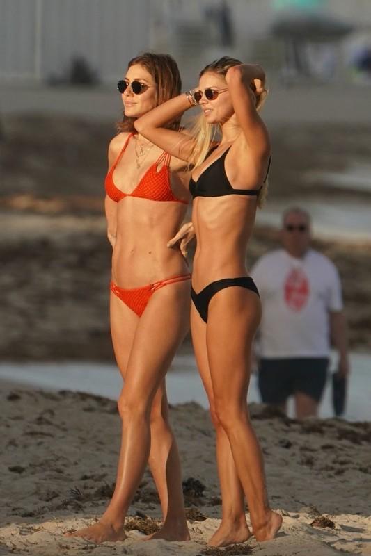 gorgeous lady Danielle Knudson in black thong bikini