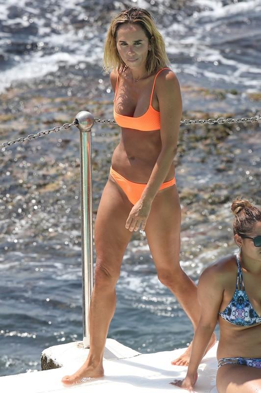 busty female Pip Edwards in sexy orange bikini