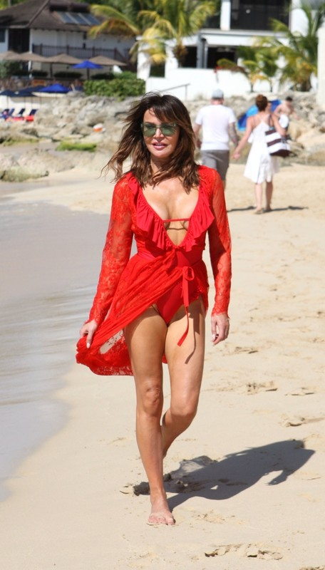 british milf Lizzie Cundy in red beach outfit