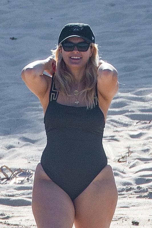 curvy lady Bebe Rexha stuns in sexy black swimsuit