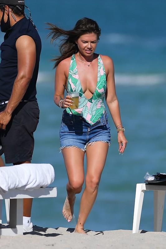 brunette hottie Chanel West Coast in swimsuit & denim shorts