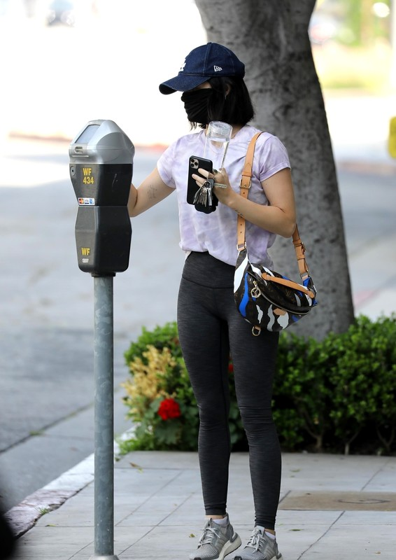 pretty chick Lucy Hale in candid yogapants