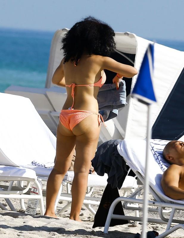 brunete cutie Shera Kerienski in orange bikini