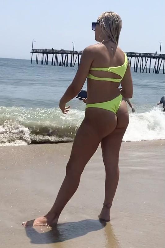 beach hottie in neon green bikini